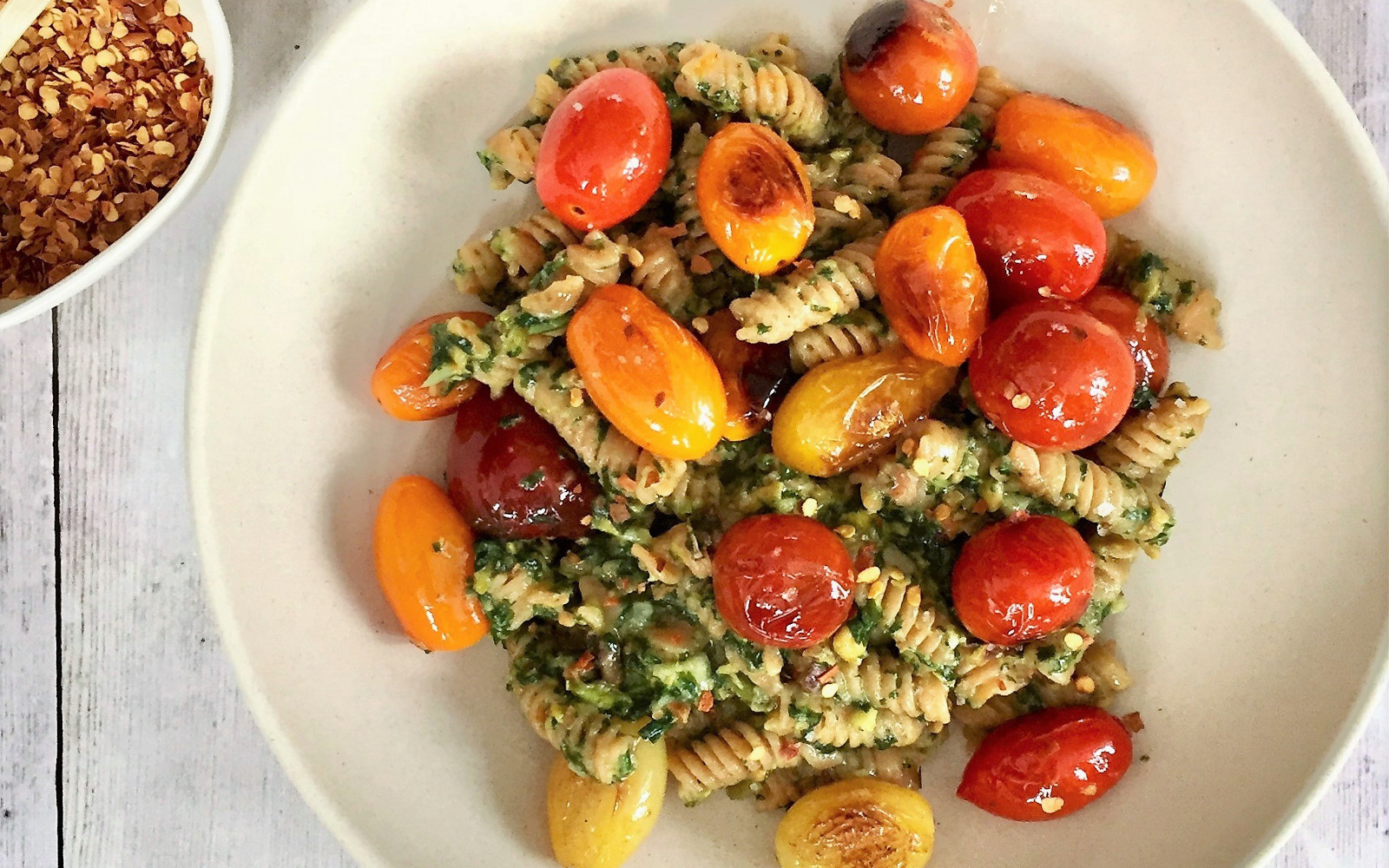 Gluten-Free Vegan Red Lentil Pasta with Basil-Pistachio Pesto with roasted colorful tomatoes