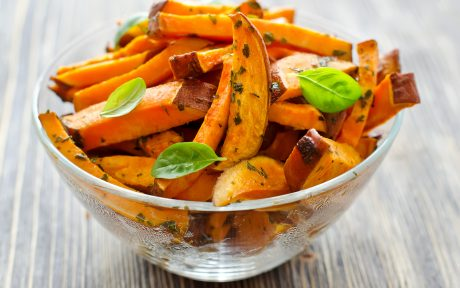 Vegan bowl of sweet potato fries with herbs