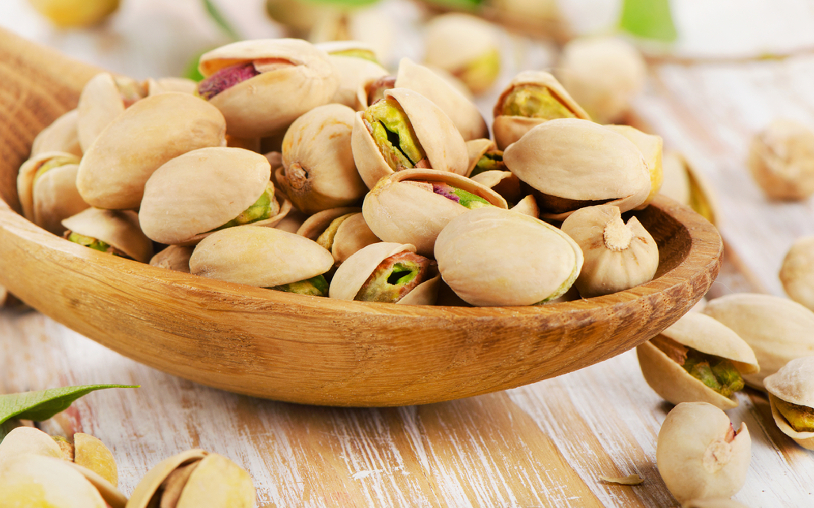 Bowl of pistachios with shells
