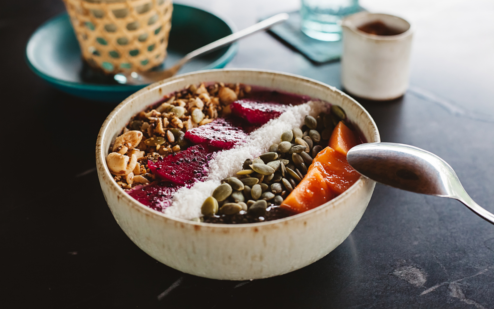 Vegan Acai bowl with fruit, coconut, and chia seeds