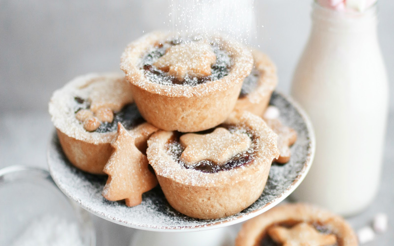 Vegan Gluten-Free Easy Mince Pies topped with sugar and crust cut out holiday shapes