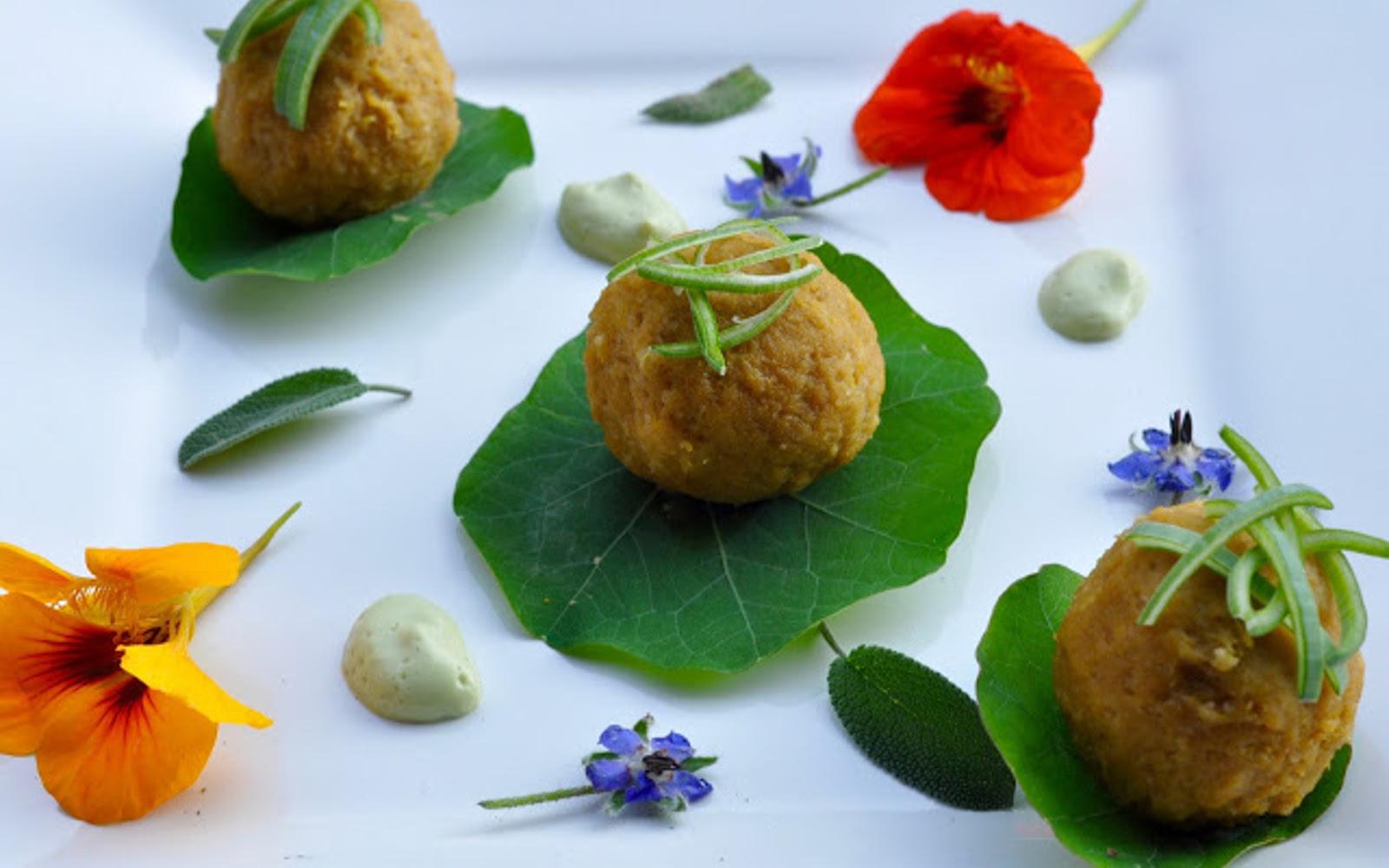 Vegan Gluten-Free Pumpkin Dumplings with Leek Sauce on leaves with garnish