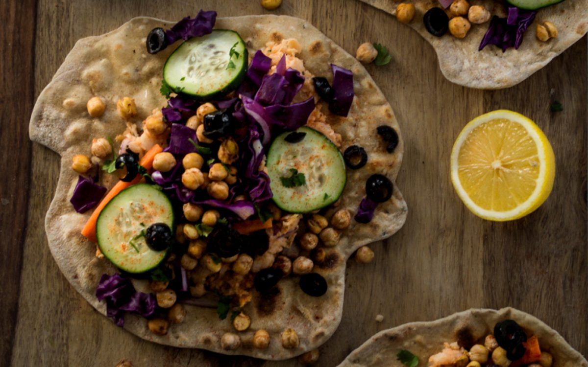 Vegan High-Protein Homemade Flatbread Wraps with White Bean Hummus and Chickpeas with lemon, cucumber, and toppings