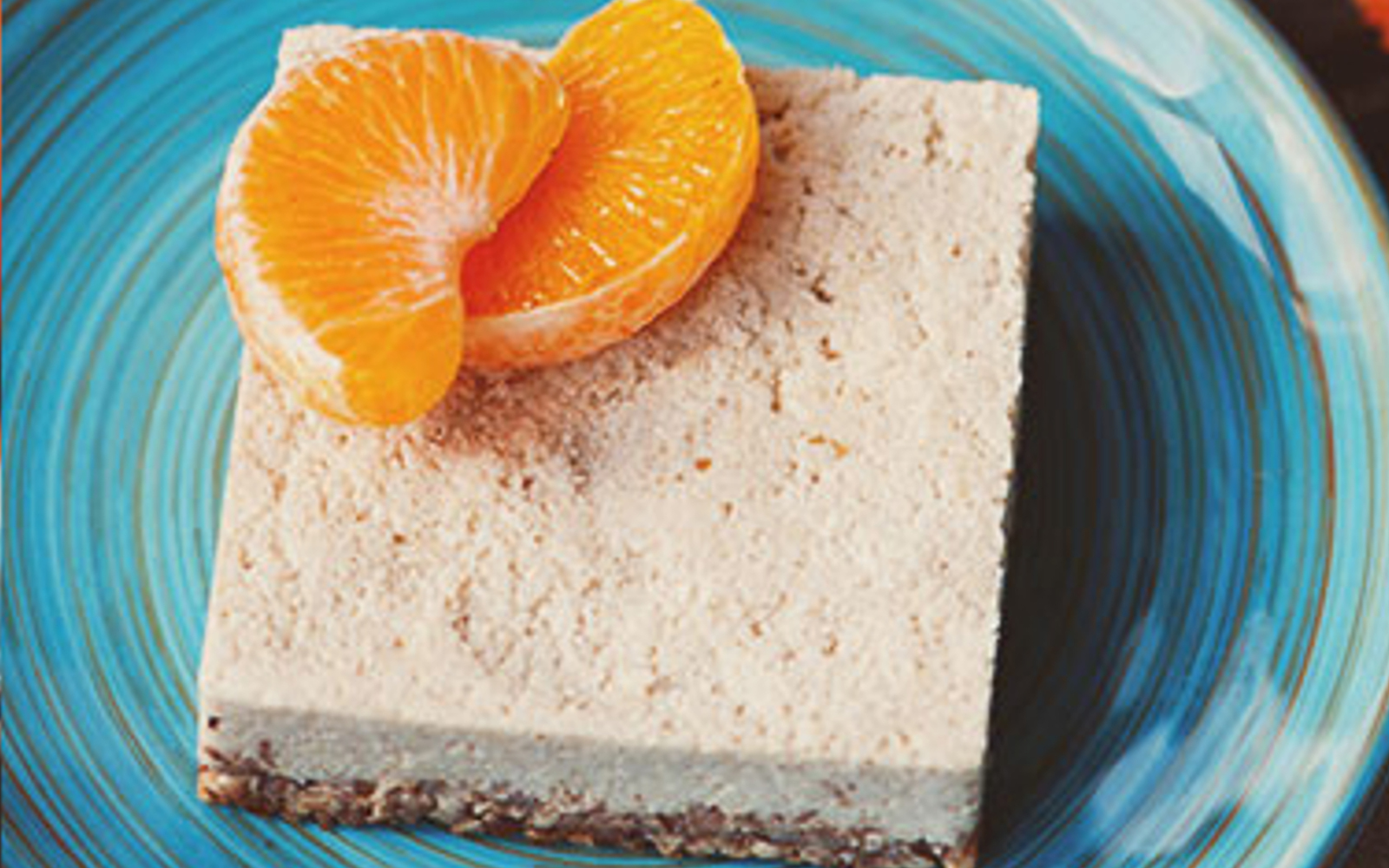 Vegan Raw Clementine Cheesecake topped with oranges