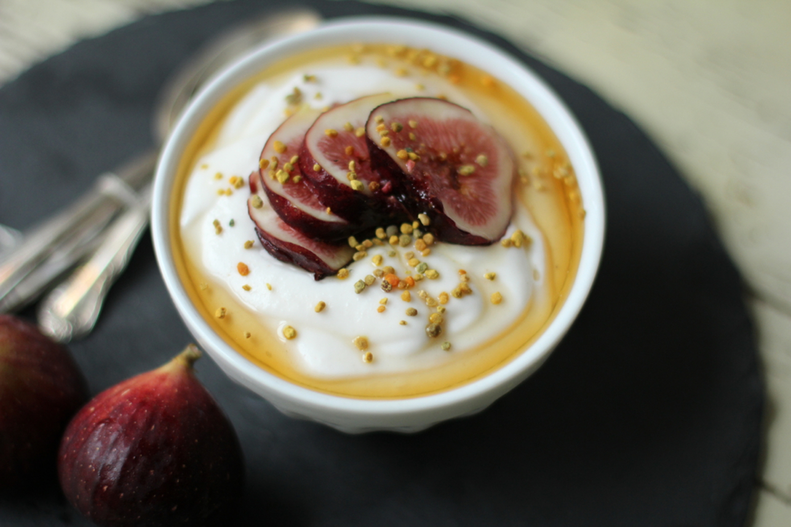 Vegan Coconut Probiotic Yogurt topped with fresh figs and maple syrup