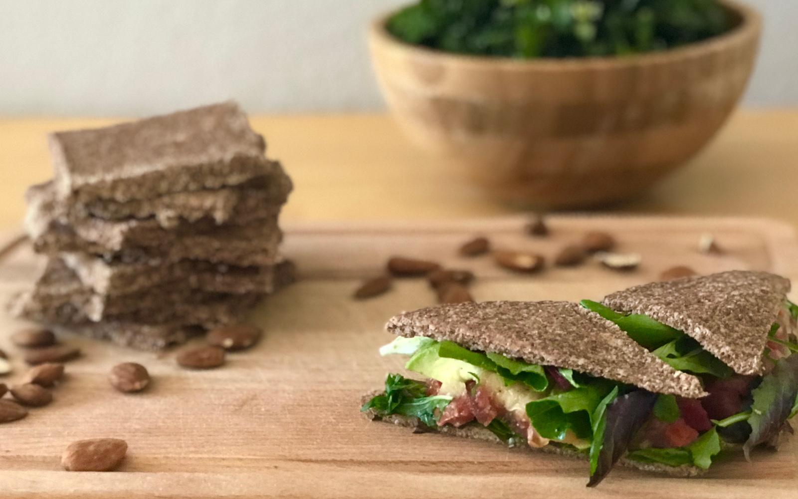 Vegan, Gluten-Free, Paleo Dehydrated Almond Bread with a sandwhich