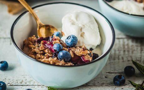 Vegan Berries and Plum Crumble with vanilla ice cream