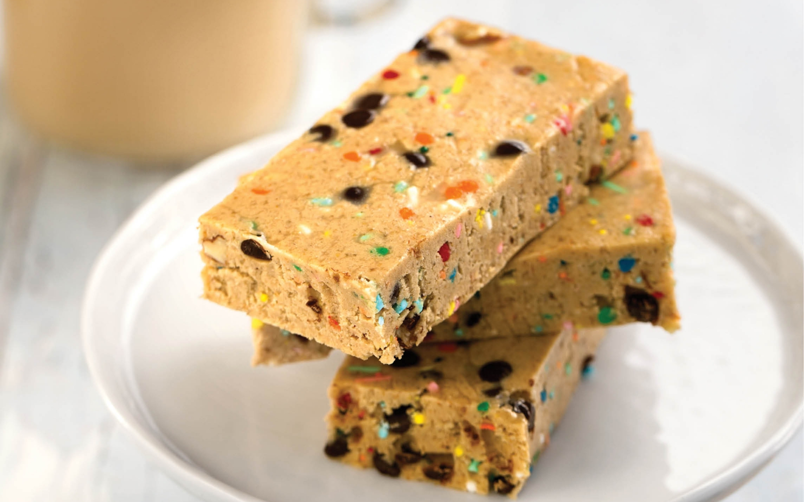 High-Protein Cake Batter Breakfast Bars with chocolate chips and sprinkles