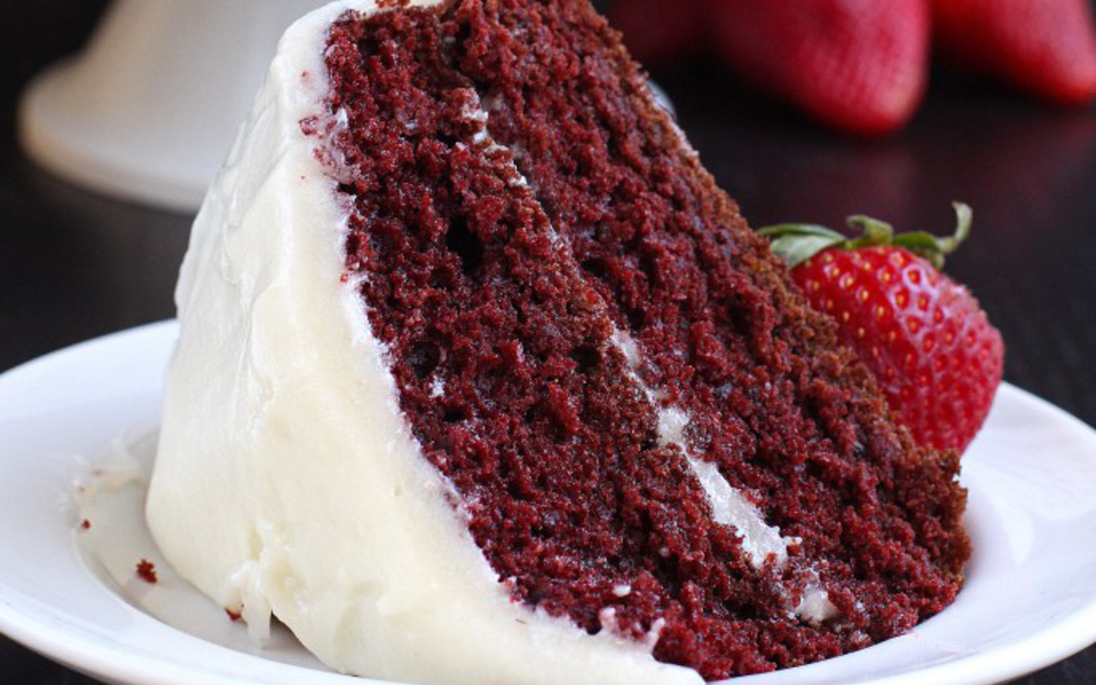Vegan Gluten-Free Classic Red Velvet Cake with cream cheese frosting and strawberry