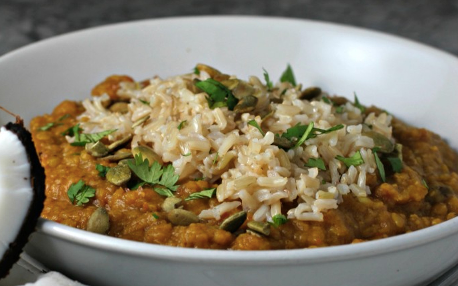 Spiced Lentil Freezer Meal [Vegan, Gluten-Free] topped with rice and fresh herbs