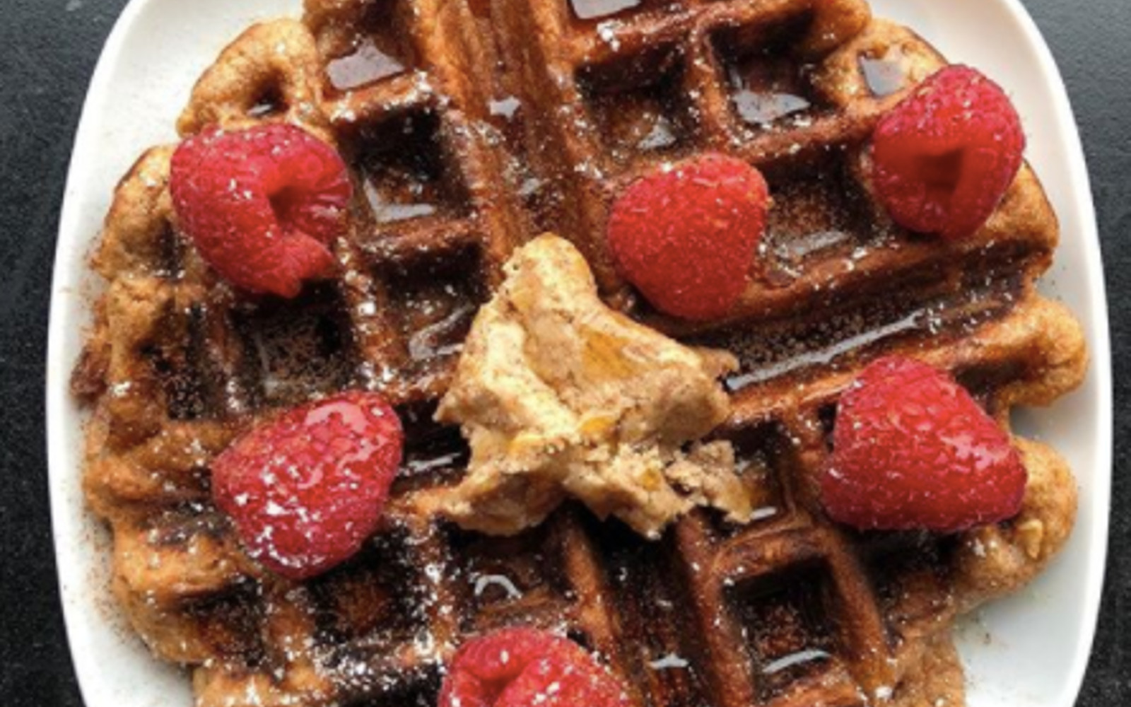 Vegan waffles with raspberries, maple syrup