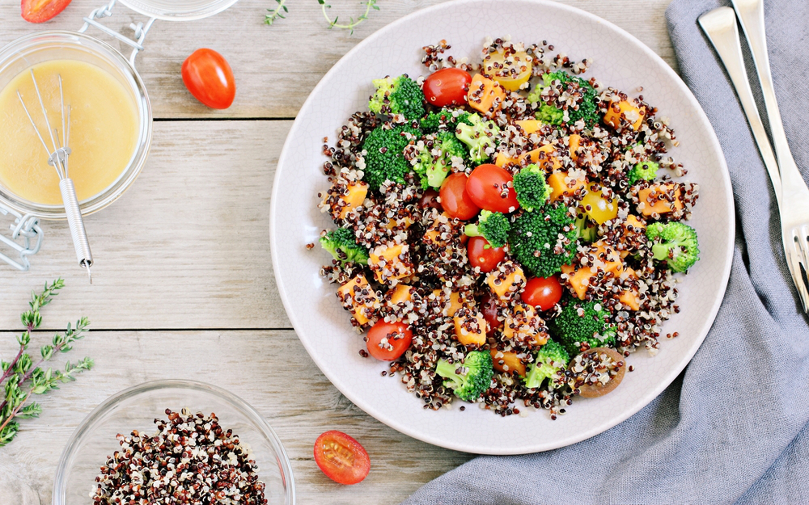 Vegan, Very colorful Quinoa salad with tomatoes, broccoli, and dressing