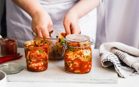Chef jarring vegan fermented Kimchi