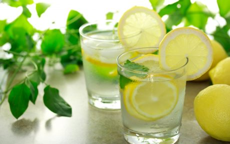 Lemon water with fresh lemons