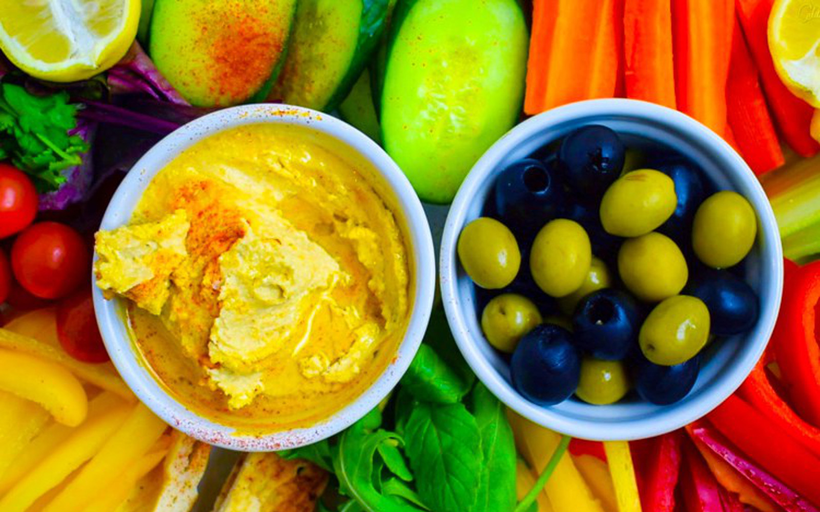 Vegan Gluten-Free Roasted Garlic Hummus with fresh vegetables and olives