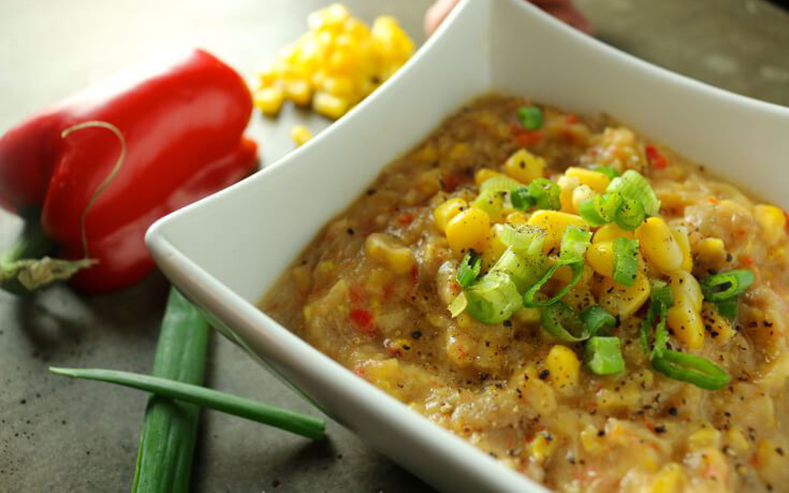 Whole-Food Plant-Based Vegan High-Carb Creamy Corn SoupHigh-Carb Creamy Corn SoupHigh-Carb Creamy Corn Soup with peppers and topping