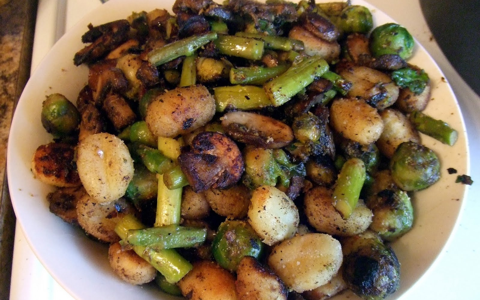 Crispy gnocchi with mushrooms, asparagus and brussels sprouts