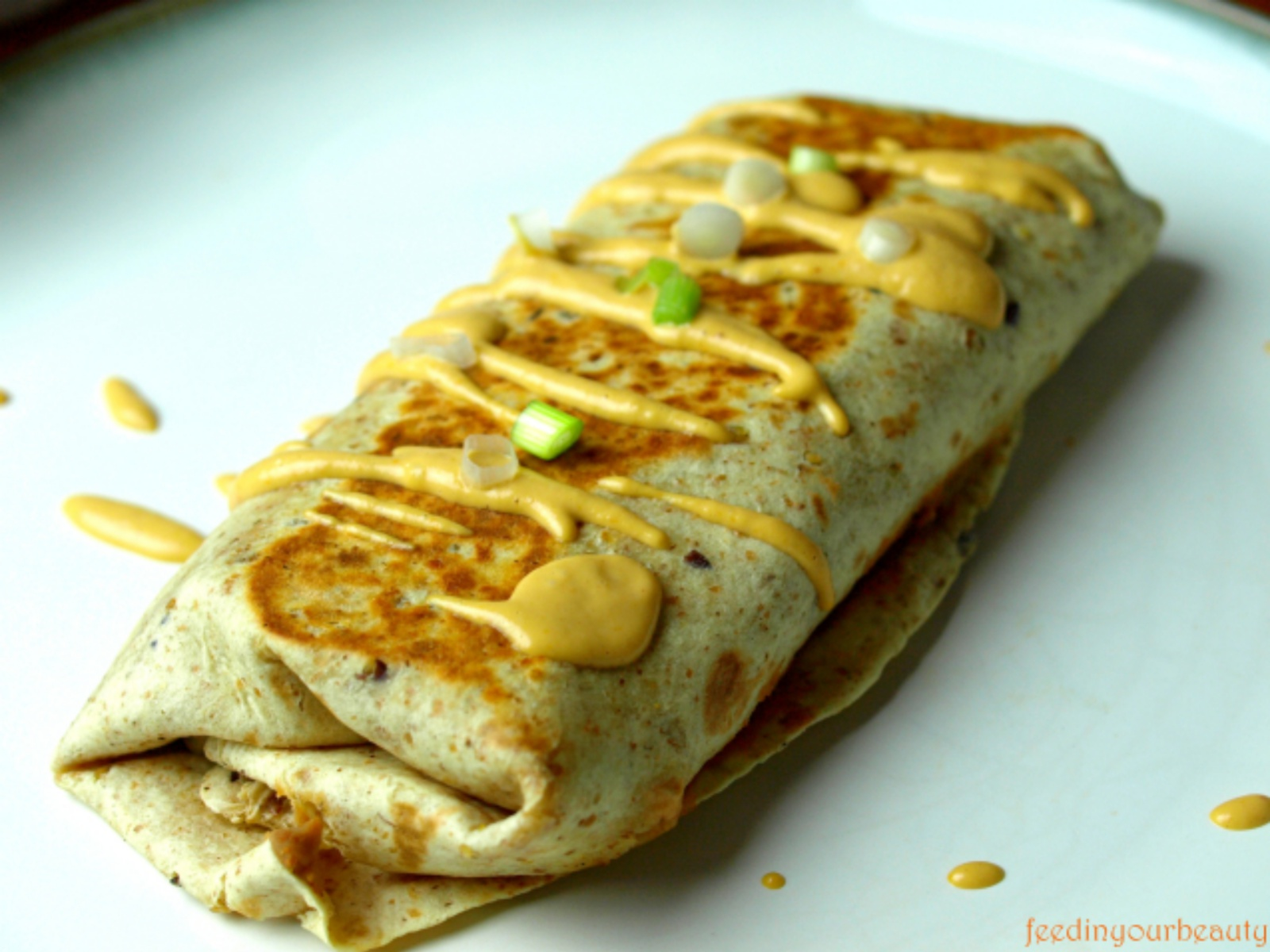 Two Potato Burritos with Mexican Cheeze Sauce