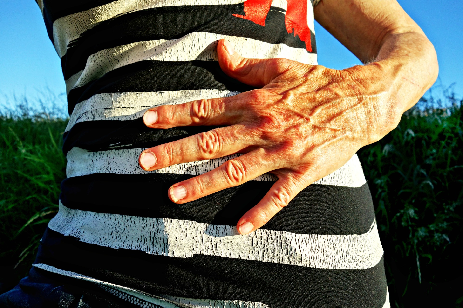 Person with hand over their stomach