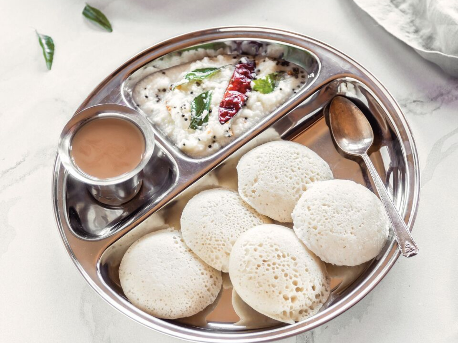 idlis: steamed rice lentil cakes with coconut chutney