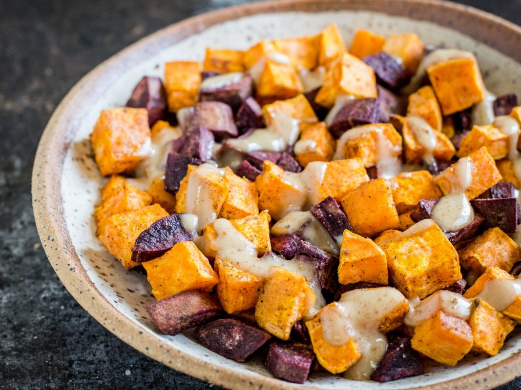 spice roasted autumn vegetables with maple tahini dressing
