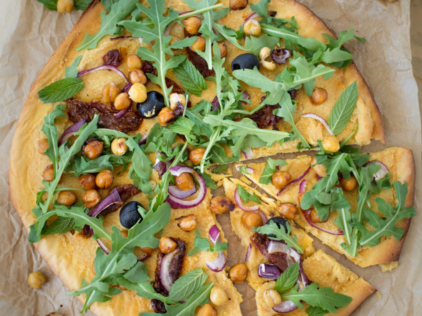 Chickpea Flour Pizza with Hummus, Sun-Dried Tomatoes and Rocket