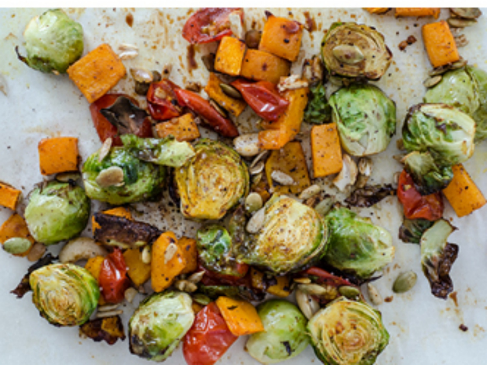 Roasted Brussels Sprouts with Pumpkin, Tomatoes, Toasted Seeds and Balsamic Vinegar