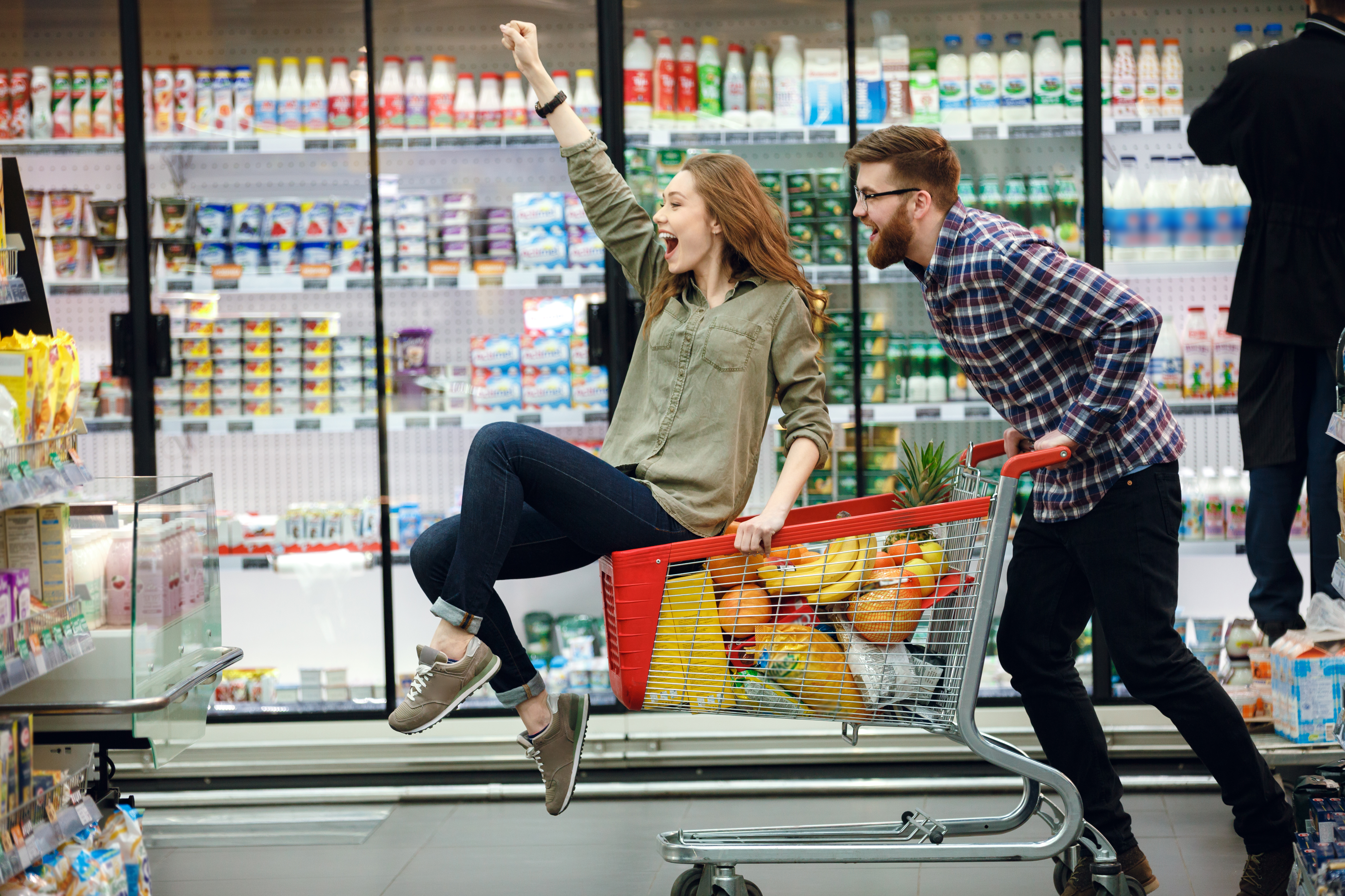 Happy couple grocery shopping