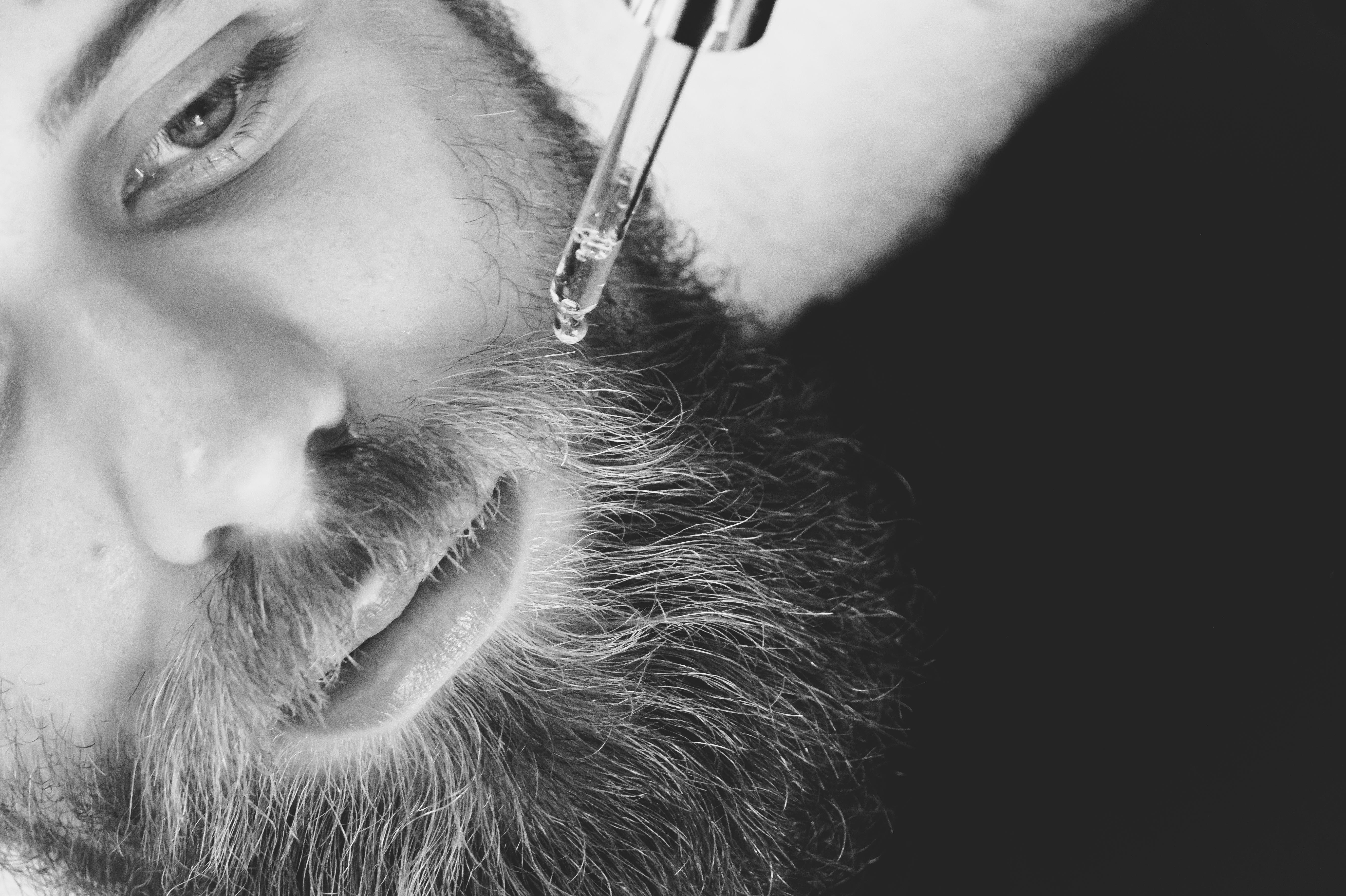 Man applying beard oil