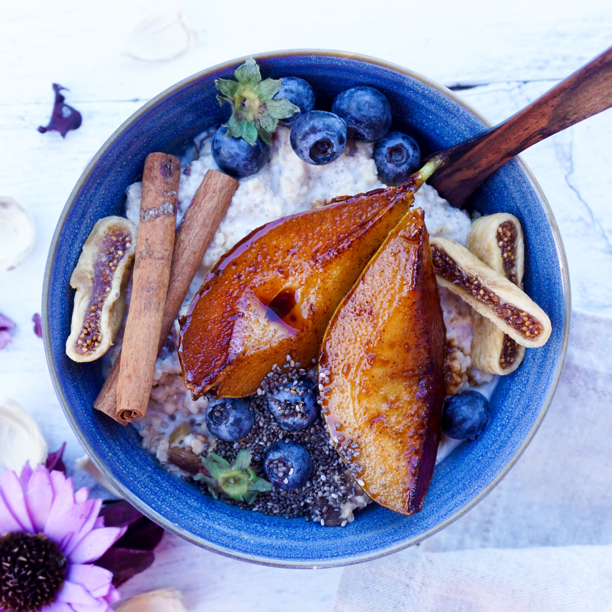 Winter Oatmeal with figs, pears, cinnamon sticks, and blueberries