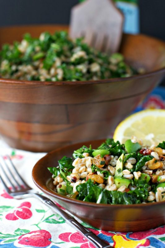 Kale salad with Farro topped with Golden Raisins and Crunchy Walnuts