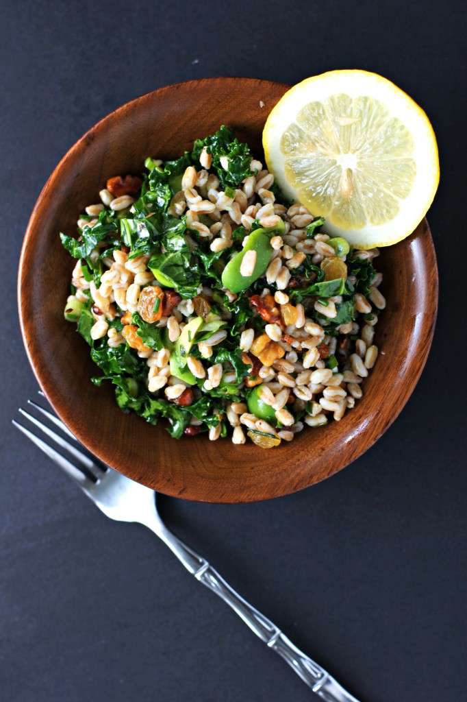 Kale salad with Farro and topped with Golden Raisins and Crunchy Walnuts