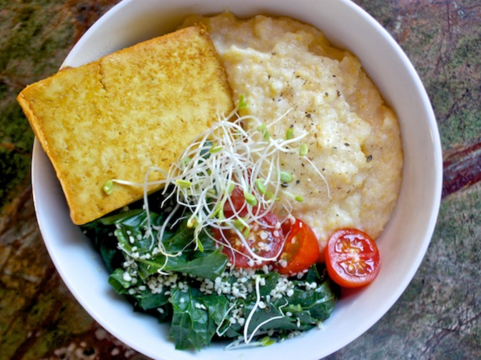Breakfast Bowl with polenta, tofu, greens, and tomatoes