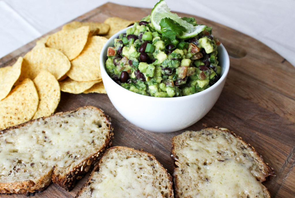 Spiced Black Bean Guacamole with bread and chips