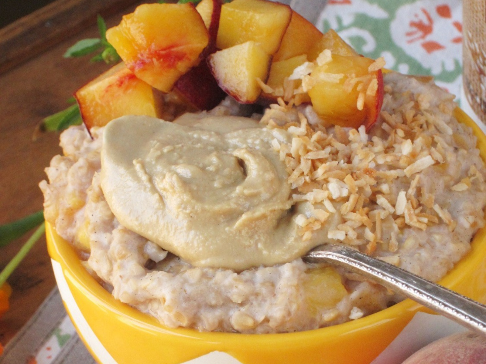 Peach Tahini Cardamom Oatmeal With Toasted Coconut