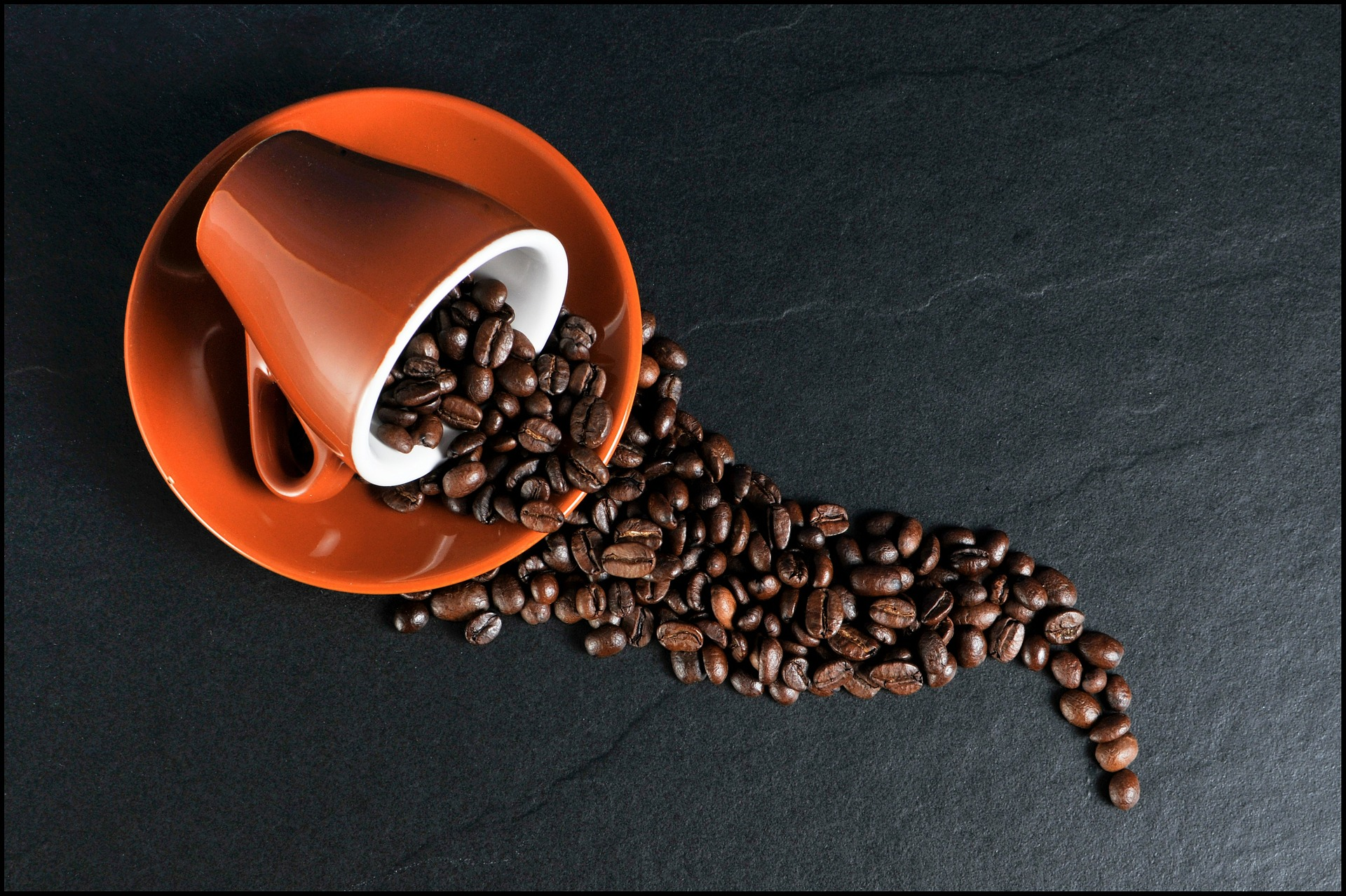 coffee beans spilling out of a mug