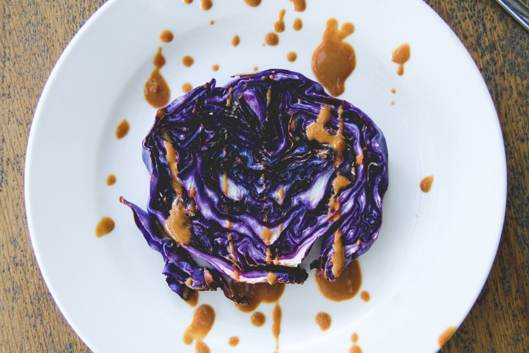 Purple Cabbage Steaks With Peanut Butter Sauce