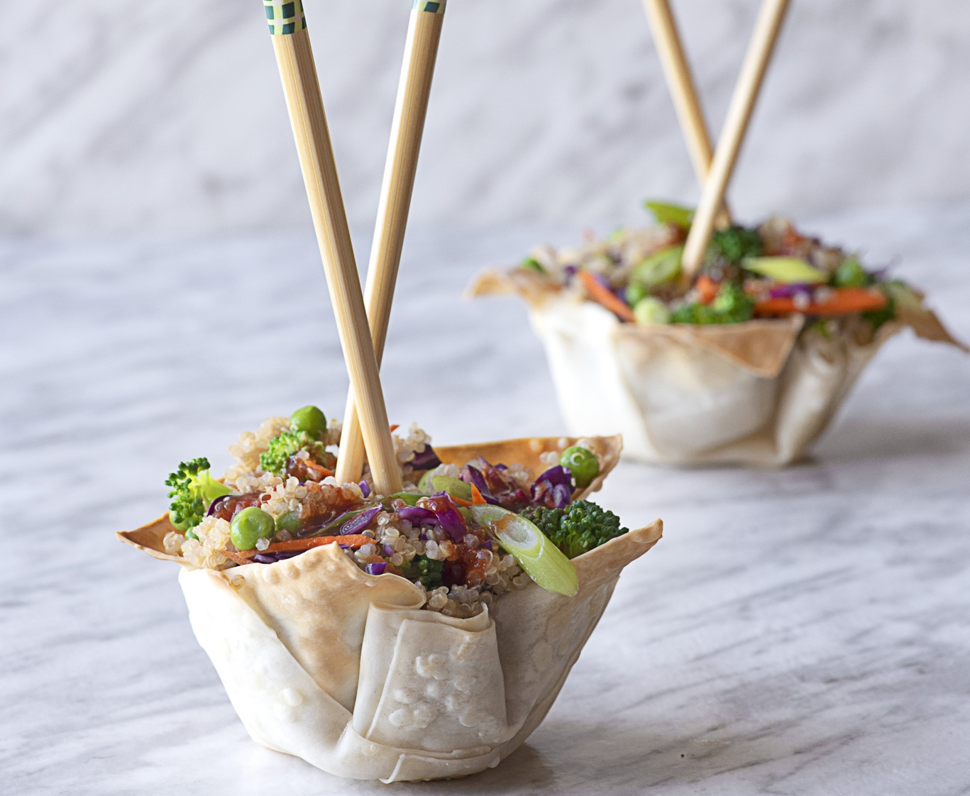Wonton bowls with garlic-fried quinoa