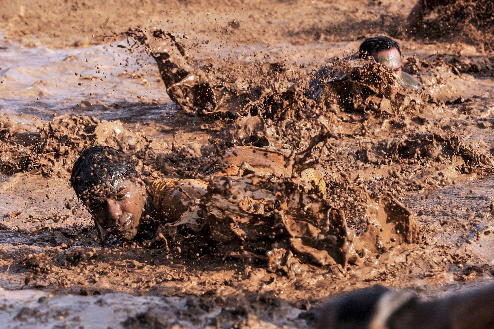People moving through mud