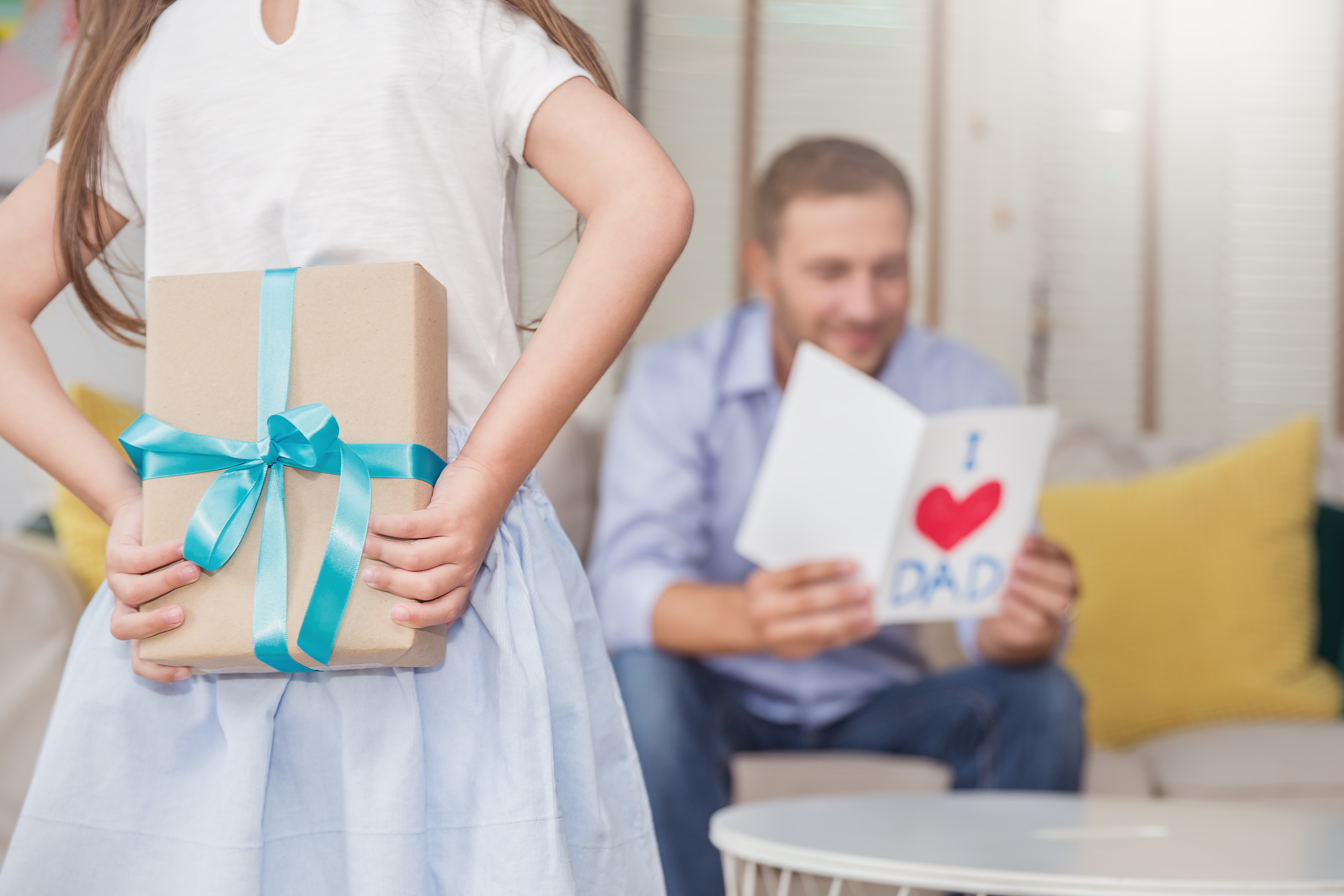 Girl giving gift to dad