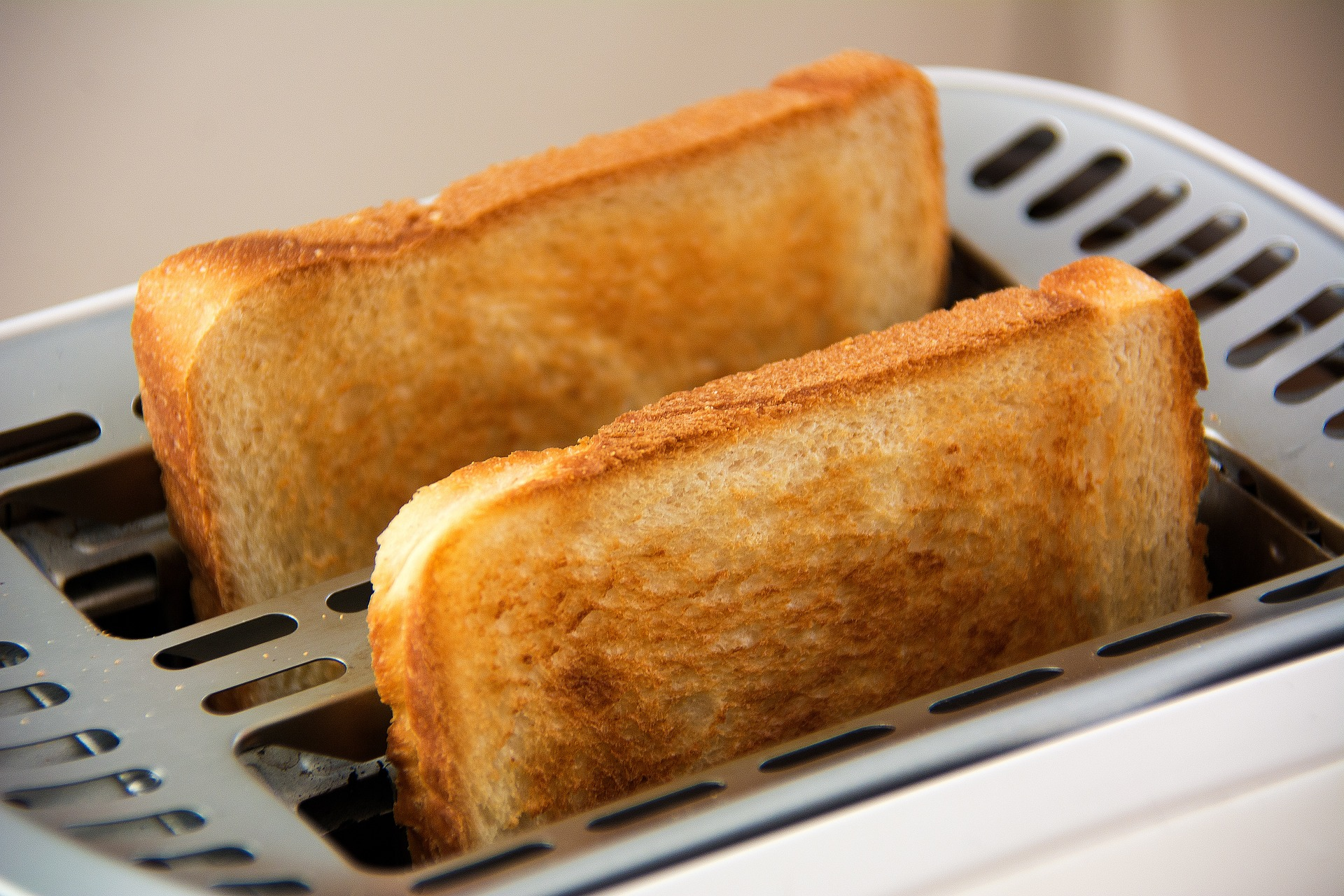 Two slices of bread in toaster