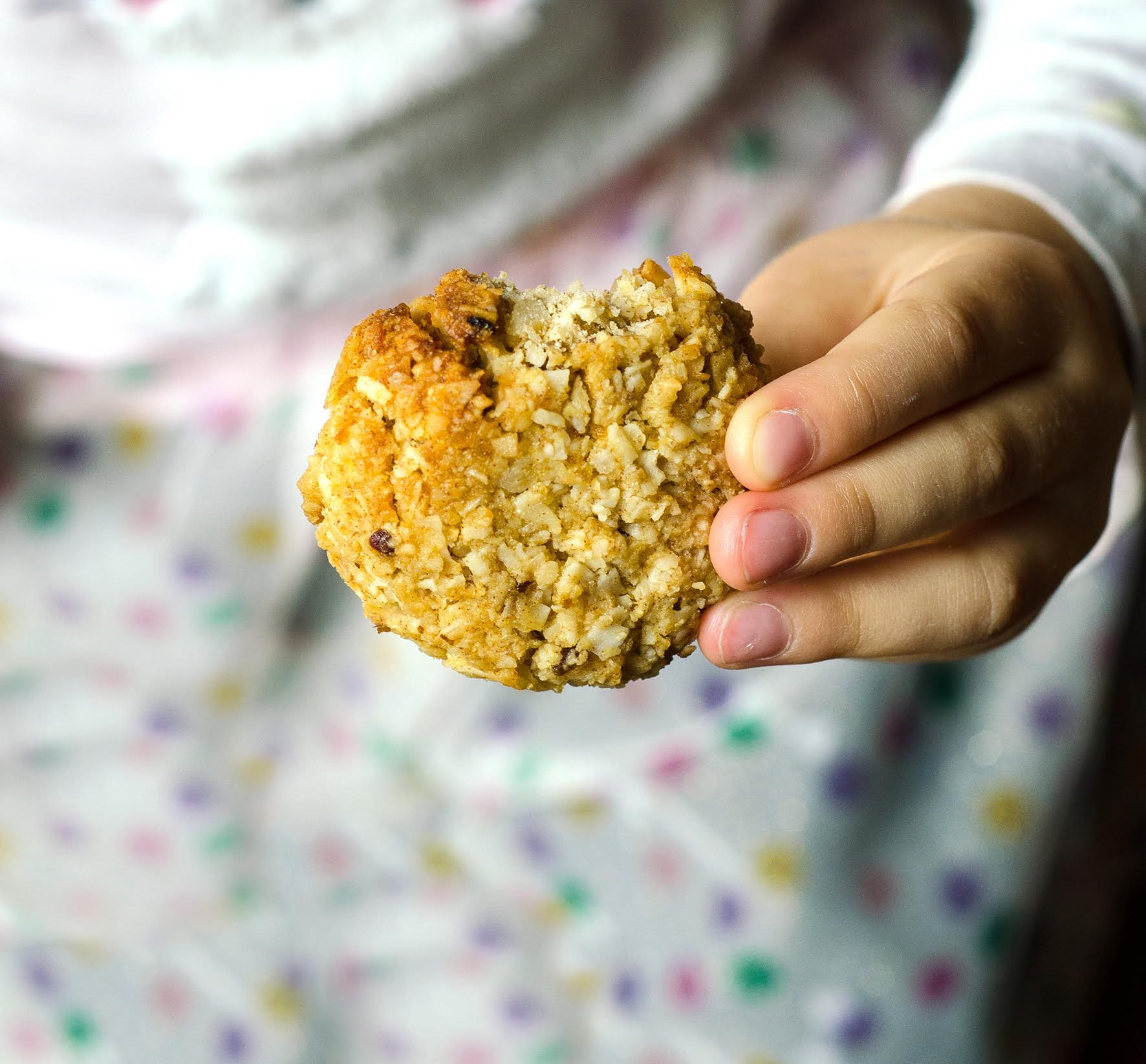 Kid holding a cookie