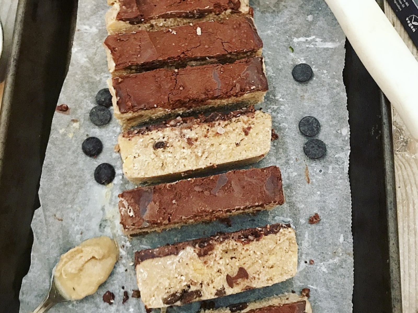 vegan protein bars with cookie dough and chocolate layers
