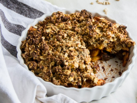 Vegan crumble with cinnamon apple and sunflower seeds