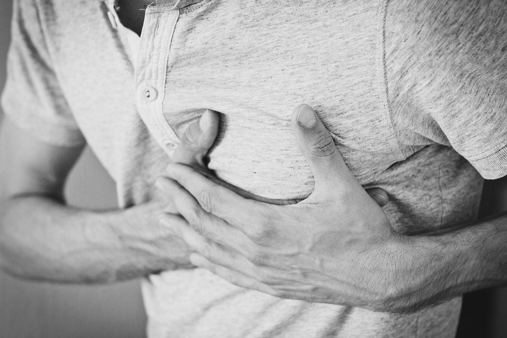 person holding their chest in pain