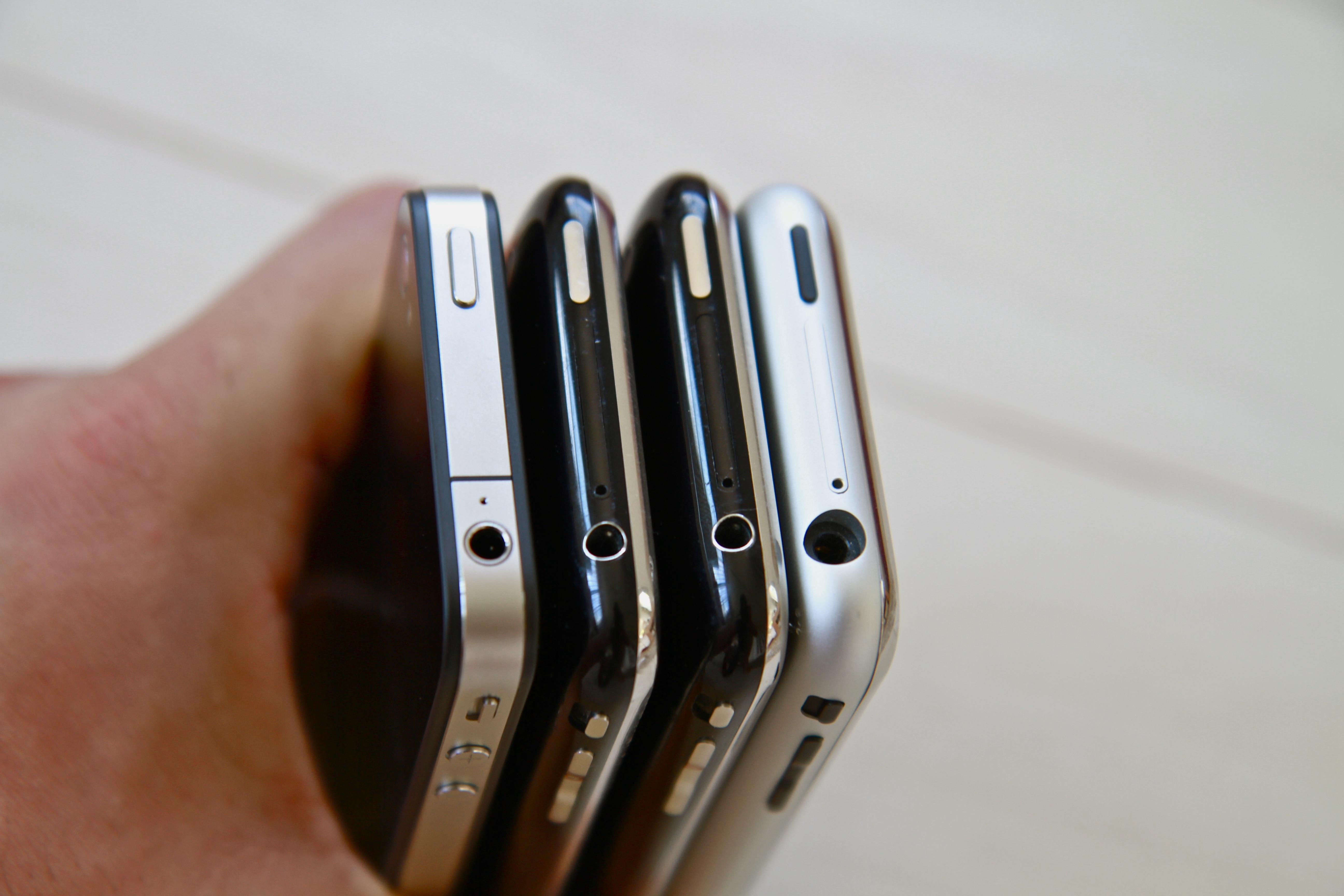 hand holding many smartphones