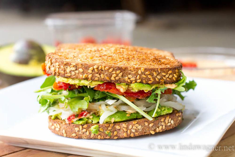 Vegan Hummus, Avocado, and Sun-dried Tomato Sandwich