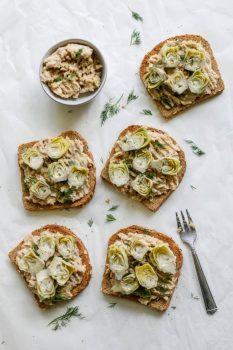 white bean ricotta artichoke toasts