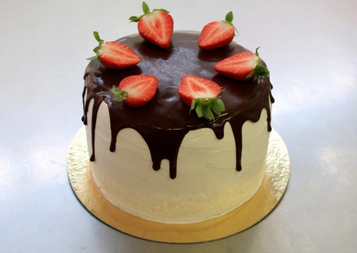 vegan White Chocolate Mousse Cake With Chocolate Drizzle and Strawberries