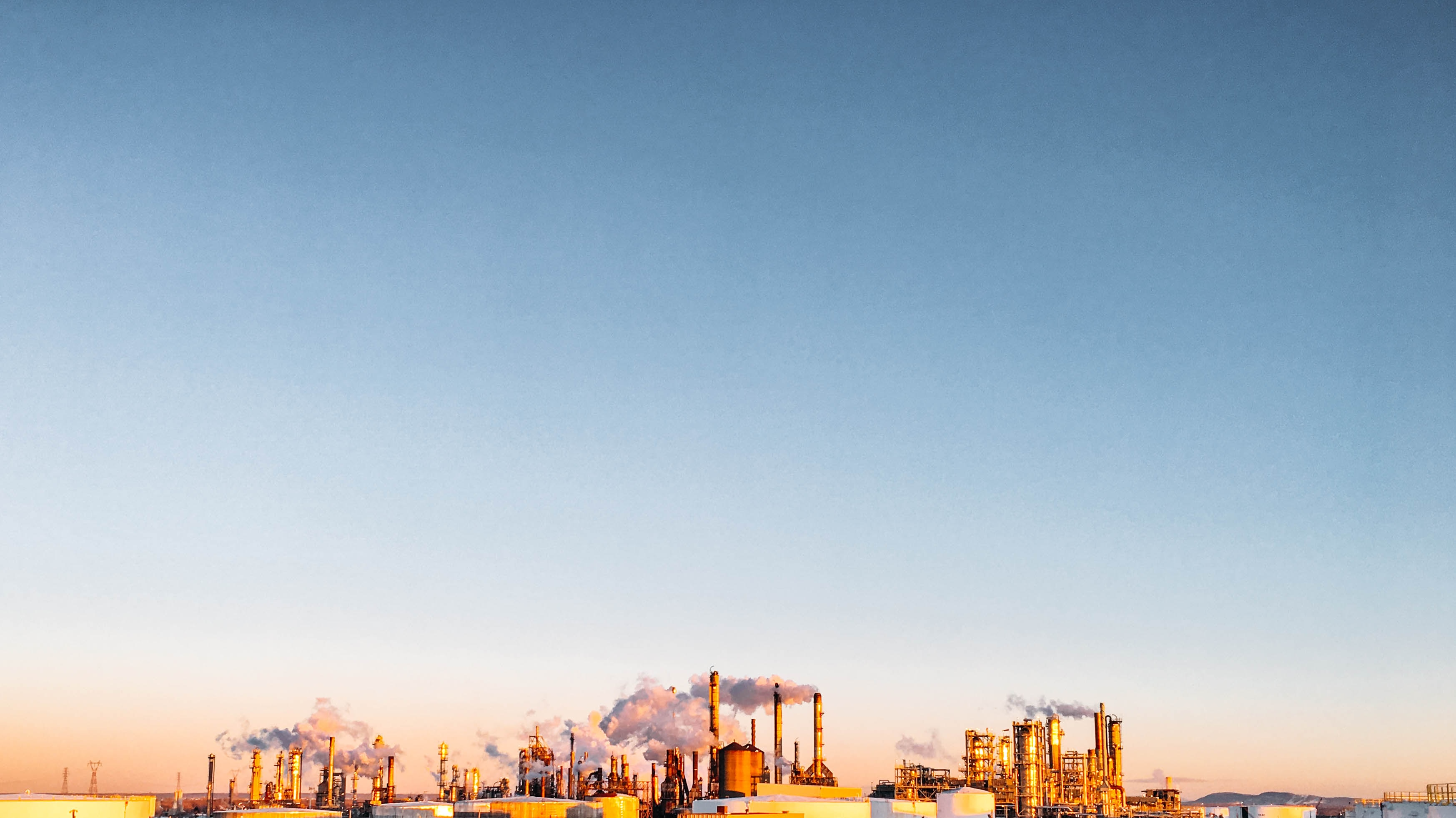 Oil Refinery Over Landscape